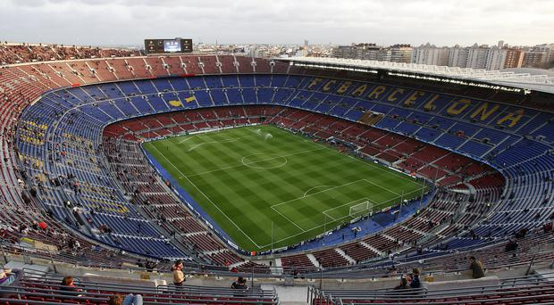 The first El Clasico of the season was set to be played at Barcelona's Nou Camp stadium (Nick Potts/PA)
