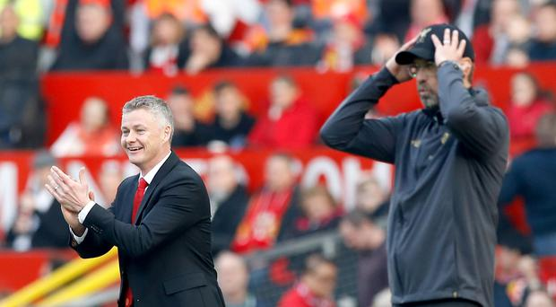 Manchester United boss Ole Gunnar Solskjaer, left, will be hoping to give Liverpool counterpart Jurgen Klopp a headache this weekend. (Martin Rickett/PA)