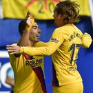 Antoine Griezmann, right, opened the scoring during Barcelona's win at Eibar (Alvaro Barrientos/AP)