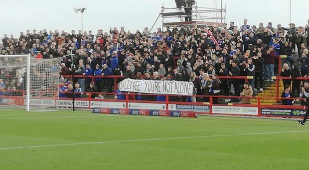 Ipswich Town fans unveil a banner at the game against Accrington Stanley (James Curtis)