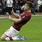AC Milan's Krzysztof Piatek celebrates his goal against Lecce (Luca Bruno/AP)