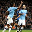 Manchester City's Raheem Sterling celebrates scoring his side's fourth goal against Atalanta (Martin Rickett/PA)