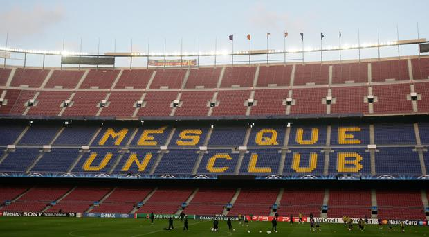 The first El Clasico clash of the season has been re-arranged for December 18 at the Nou Camp (Dave Thompson/PA)