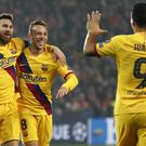Barcelona's Lionel Messi, left, celebrates with team-mates after scoring (Petr David Josek/AP)