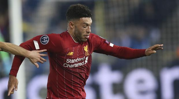 Alex Oxlade-Chamberlain scored twice as Liverpool eased to victory in Belgium (Francisco Seco/AP)