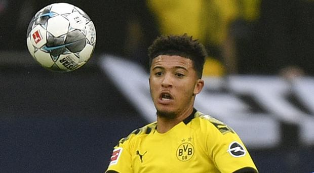 Jadon Sancho in action against Schalke (Martin Meissner/AP)