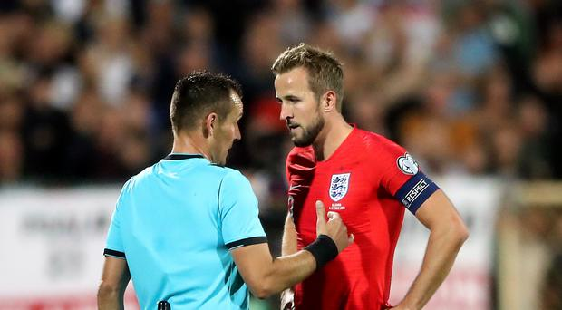 Harry Kane, right, speaks to referee Ivan Bebek after racist abuse is reported during the Bulgaria v England match (Nick Potts/PA)