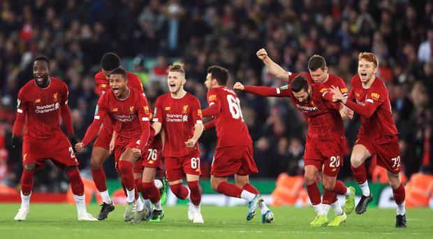 Liverpool players celebrate winning the penalty shootout (Mike Egerton/PA)