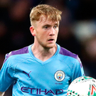 Stuck in: Tommy Doyle during his Manchester City debut