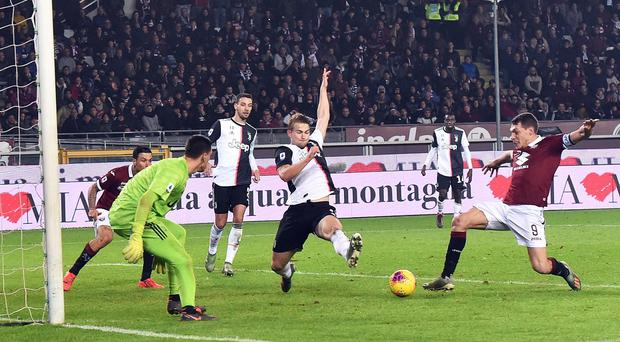 Torino's Andrea Belotti, right, goes close during his side's derby defeat to Juventus (Andrea Di Marco/ANSA via AP)