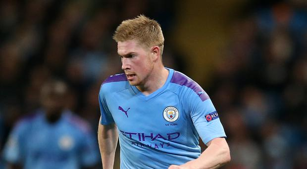 Stuck in: Kevin de Bruyne is fired up to take on Liverpool
