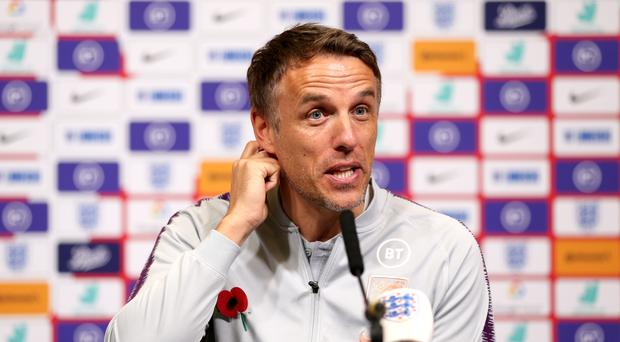 Phil Neville will lead his England side out in front of a record crowd at Wembley (Steven Paston/PA)