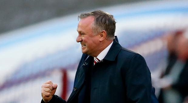 Stoked up: Michael O'Neill urges his new club Stoke to victory at Barnsley on Saturday