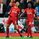 Roaring success: Fabinho celebrates his strike which opened the scoring