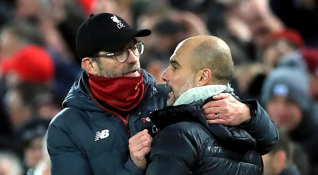 Liverpool manager Jurgen Klopp (left) and Manchester City manager Pep Guardiola are said to agree change is needed to the use of VAR (Peter Byrne/PA)