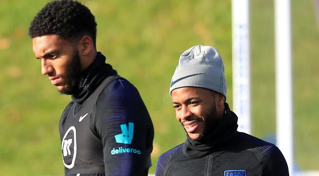England's Joe Gomez and Raheem Sterling during training at St George's Park (Mike Egerton/PA)
