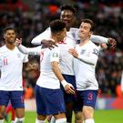 England's Tammy Abraham, centre, celebrates scoring his side's seventh goal against Montenegro (Nick Potts/PA)