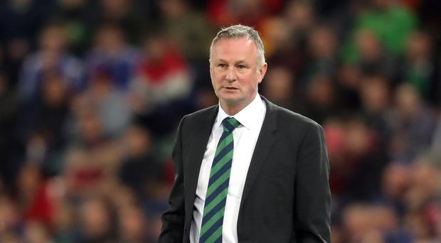 Michael O'Neill has stopped short of confirming he will manage Northern Ireland if they face a Euro 2020 qualifying play-off in March (Niall Carson/PA)