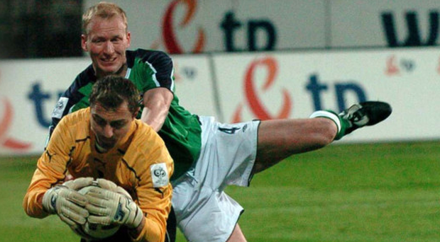 Battle: NI's Colin Murdock tussles with Poland and Liverpool keeper Jerzy Dudek