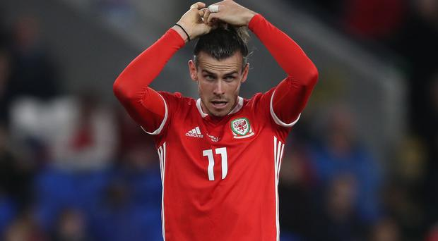 Gareth Bale will miss Wales' final Euro 2020 qualifier against Hungary if he is booked in Azerbaijan on Saturday (Nick Potts/PA)