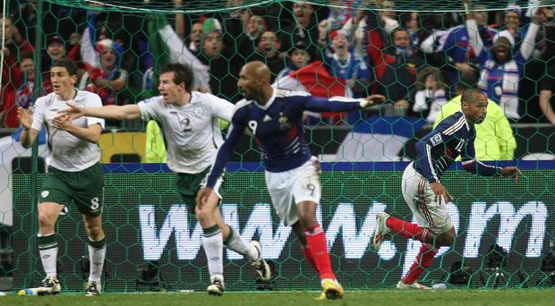 France's Thierry Henry (right) celebrates after setting up William Gallas to score (Martin Rickett/PA)