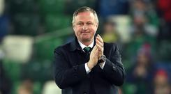 Michael O'Neill applauded the fans after what stands to be his final game in charge at Windsor Park (Liam McBurney/PA)