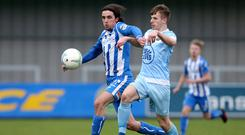 Tight tussle: Warrenpoint's Kris Cowan battles with Coleraine's Jamie Glackin