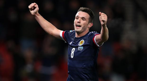 Scotland's John McGinn celebrates scoring his side's third goal against Kazakhstan (Steve Welsh/PA)