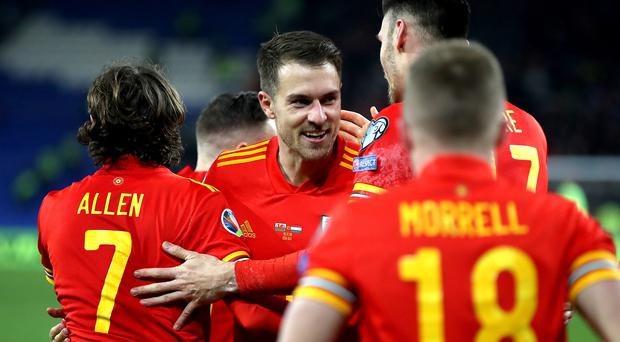 Aaron Ramsey (centre) is relishing his return to the Euros with Wales (Nick Potts/PA)