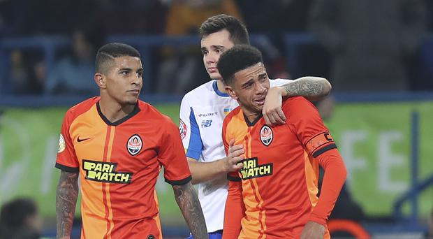 Taison (right) was sent off for responding to alleged racism (Oleksander Osipov/AP)