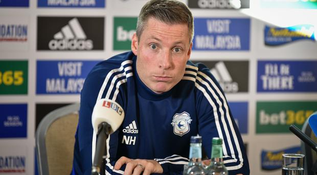 Cardiff City's new manager Neil Harris saw his side fight back from 2-0 down to earn a point at Charlton.