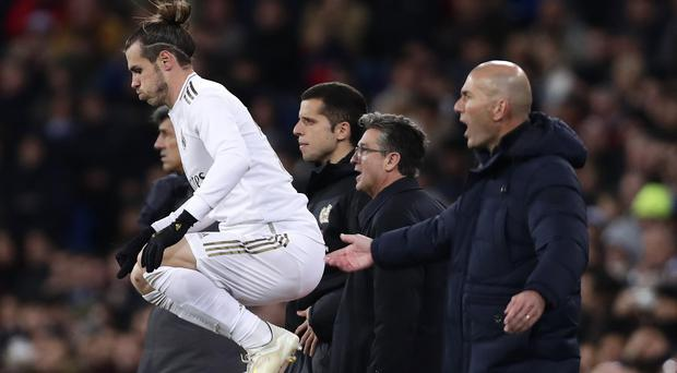 Gareth Bale was sent on for the closing stages and helped set up Real Madrid's third goal (Manu Fernandez/AP)
