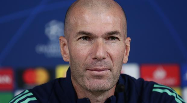 Zinedine Zidane's Real Madrid can qualify for the last 16 of the Champions League on Tuesday (Manu Fernandez/AP)