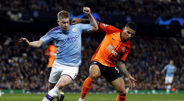 Manchester City progress in the Champions League despite being held to a draw by Shakhtar Donetsk (Martin Rickett/PA)