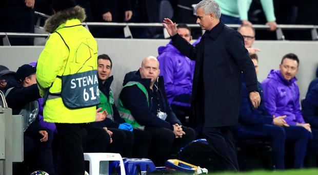 Jose Mourinho congratulates the ballboy after his role in returning the ball quickly for Tottenham's equaliser (Adam Davy/PA)