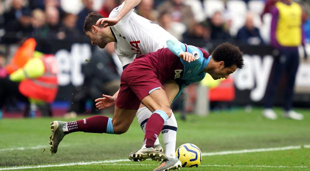 Tottenham defender Ben Davies (top) suffered ankle ligament damage in the win at West Ham (John Walton/PA)