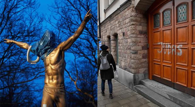 A statue of Zlatan Ibrahimovic and the footballer's property, which have both been vandalised (Andreas Hillergren/Jessica Gow/TT/AP)