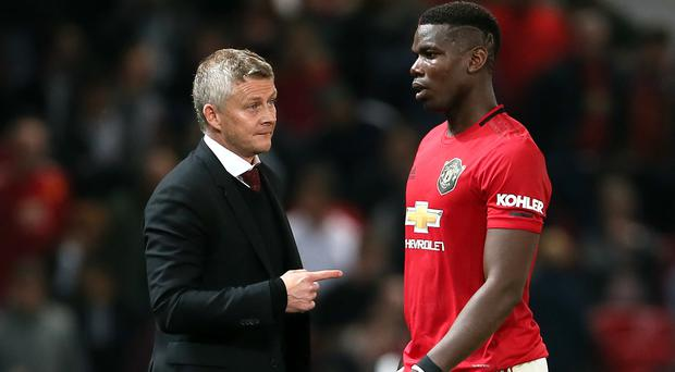 Manchester United manager Ole Gunnar Solskjaer (left) has defended Paul Pogba's professionalism (Richard Sellers/PA)
