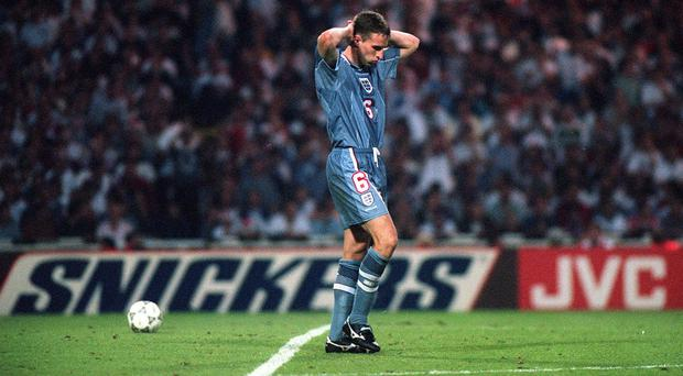 Gareth Southgate looks dejected after missing a penalty in England's shoot-out defeat to Germany at Euro 96 (PA)