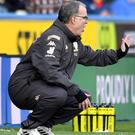 Leeds manager Marcelo Bielsa has demanded improvement from his side despite their 2-0 win at Huddersfield (Anthony Devlin/PA Images).