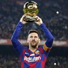 Lionel Messi showed off his sixth Ballon d'Or ahead of scoring a hat-trick in a 5-2 win over Mallorca (Joan Monfort/AP)