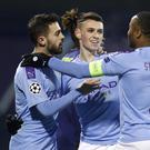Phil Foden, second right, was lauded by Pep Guardiola (Darko Bandic/AP)