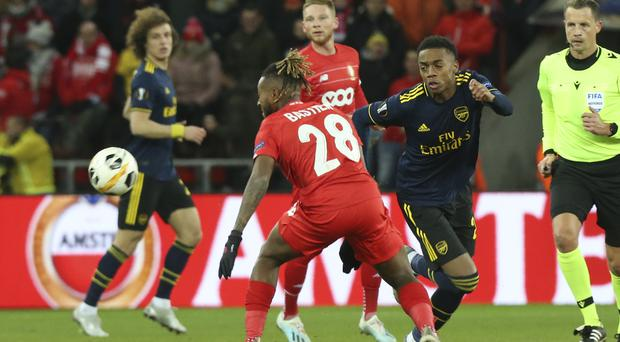 Arsenal claimed a vital draw in Belgium (Francois Walschaerts/AP)