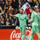 Karim Benzema, second left, is congratulated by team-mates after earning Real Madrid a point against Valencia (Alberto Saiz/AP)