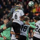 Real Madrid's goalkeeper Thibaut Courtois scores during the Spanish La Liga soccer match between Valencia and Real Madrid at the Mestalla Stadium in Valencia, Spain, Sunday, December 15, 2019. (AP Photo/Alberto Saiz)