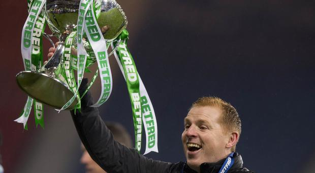 Celtic manager Neil Lennon celebrates with the Betfred Cup (Jeff Holmes/PA)
