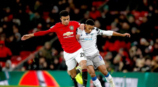 Manchester United's Mason Greenwood (left) and Colchester United's Cohen Bramall (right) during the Carabao Cup quarter final match at Old Trafford (Martin Rickett/PA)