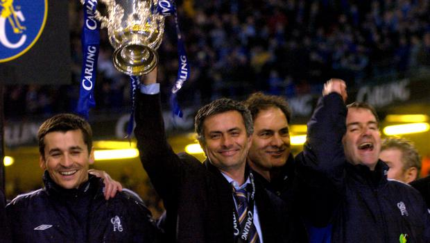 Mourinho holds up his first silverware as Chelsea boss following a Carling Cup final win over Liverpool (Rebecca Naden/PA)