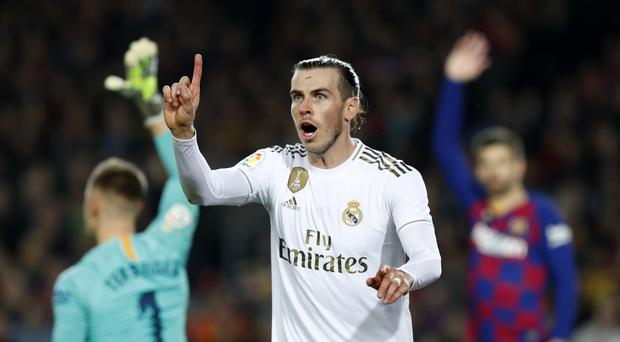 Gareth Bale had a goal ruled out as real Madrid and Barcelona played out a goalless draw (Joan Monfort/AP)