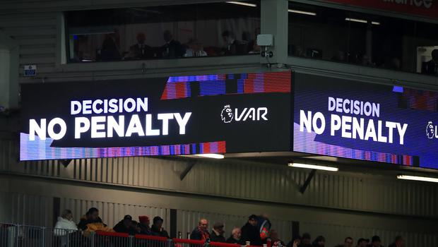 The VAR screen shows a 'No Penalty' decision at Anfield (Peter Byrne/PA)